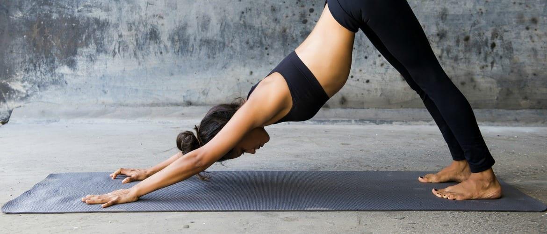 a woman doing a downward facing dog yoga pose