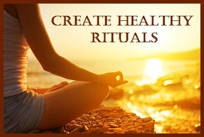 "a woman by the sea meditating with the caption ""CREATE HEALTHY RITUALS"" along the photo"